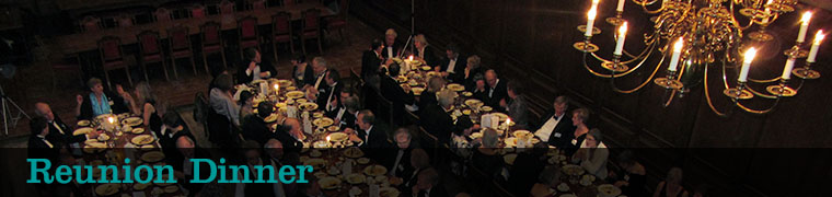 aerial photo of people sitting in call eating dinner by candlelight with text 'reunion dinner'