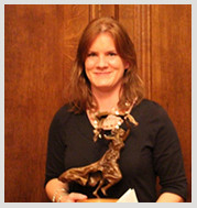 photo of Natalie Roberts holding the Alumni of the Year statue